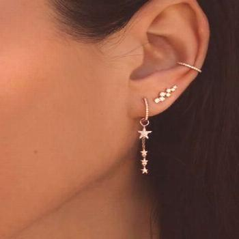 14kt gold and diamond dripping star earring -