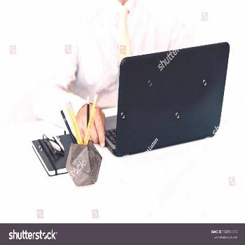 man typing on keyboard laptop computer, holder with pencils and pens, stack of books, notebooks, sm
