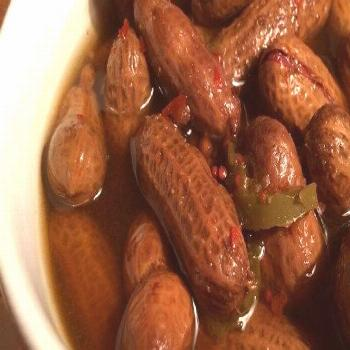 Rachael's Superheated Cajun Boiled Peanuts Recipe -  Raw peanuts in their shells simmer in a salty,