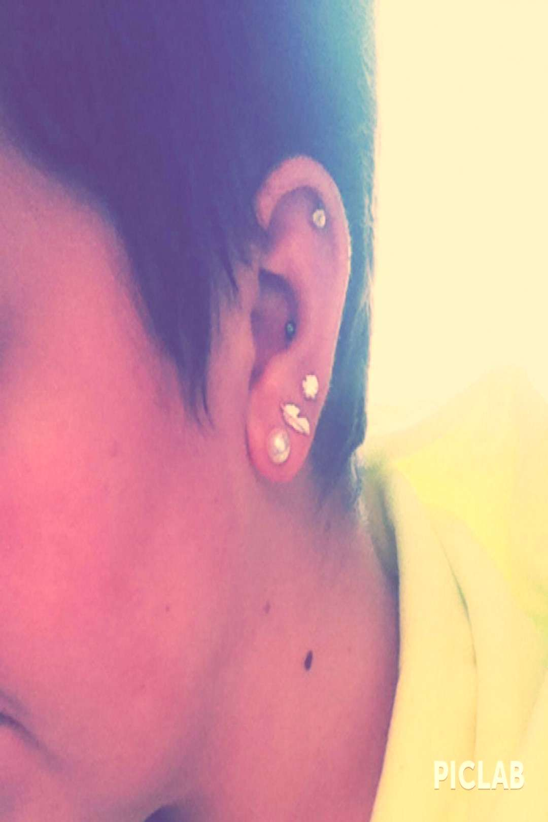 5 ear peircing. 1st,2nd,3rd, conch, cartilage. earpeircings