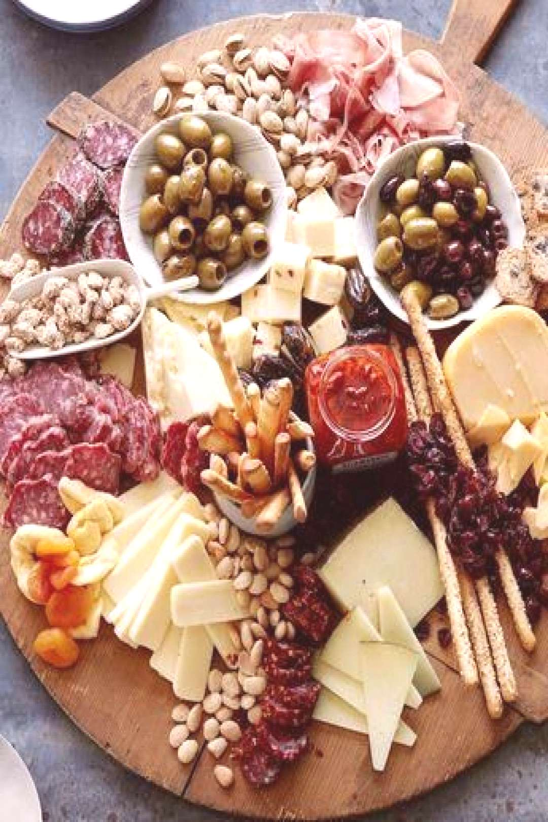 Appetizer plate: cheese, sausage, olives, grissinis, dips, peanuts, ... - Food -