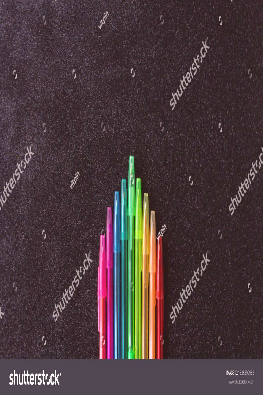 Color pens all the colors of the the rainbow. Isolated object. Black sparcle background. ,