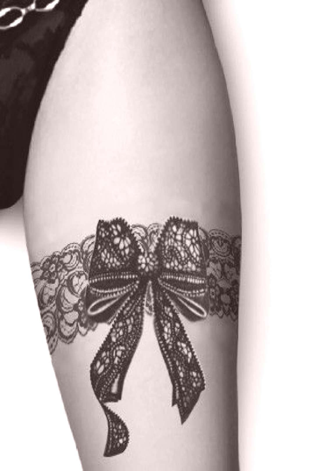 Garter tattoo with a bow on the thigh - Garter tattoo with a bow on the thigh -