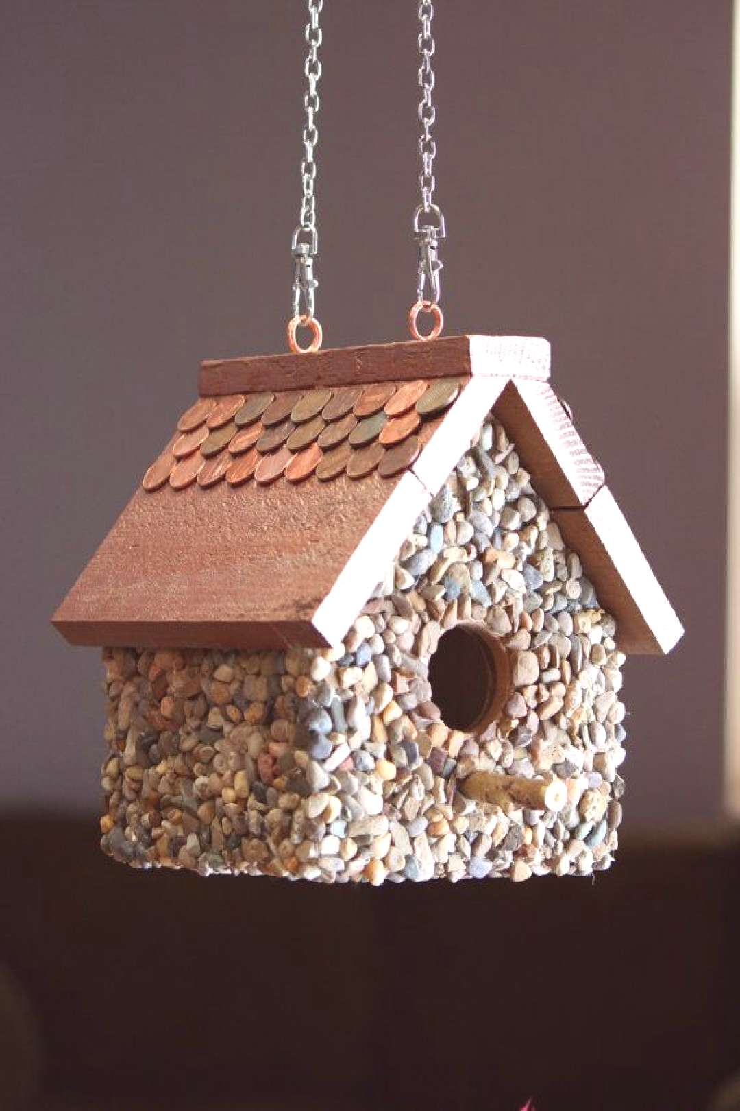Items similar to birdhouse built from scrap wood, pebbles and pennies on Etsy#birdhouse