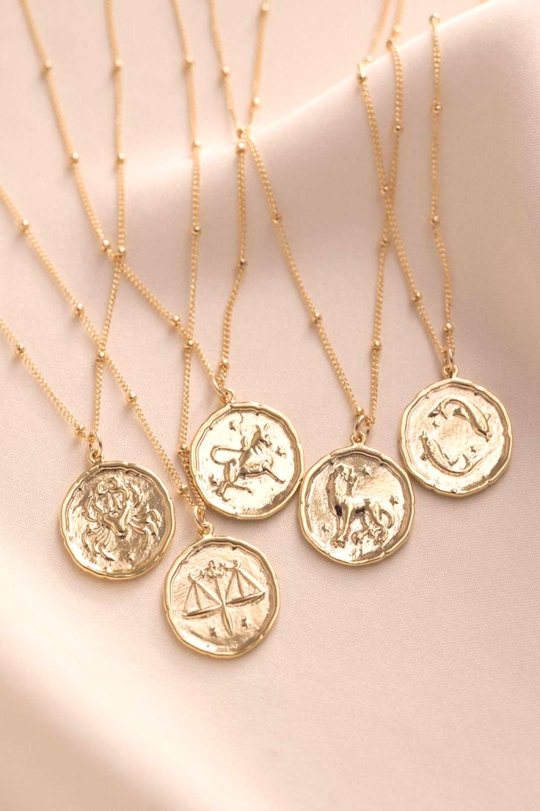 Our zodiac coin necklace is the perfect personalized gift for anyone - whether youre a Scorpio, Ge