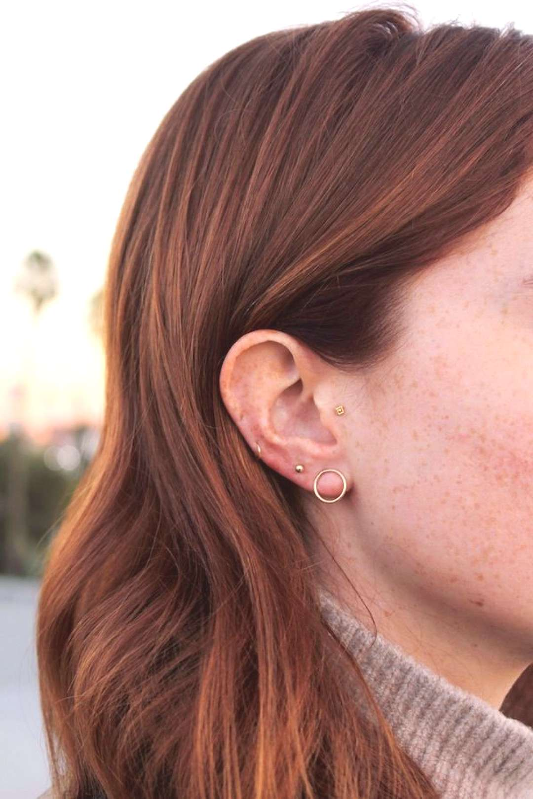 Style Tweak: Minimal Multiple Earrings -  When I was about three, my dad took me to pierce my ears
