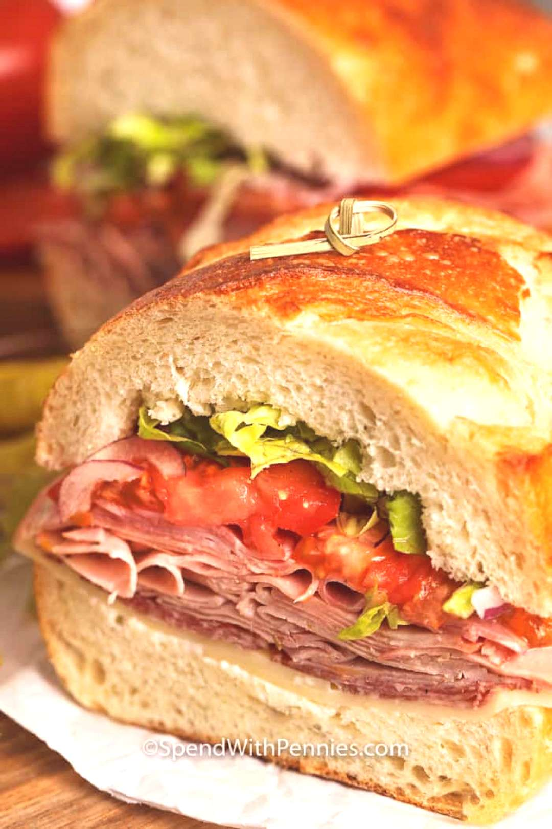 This Italian Sub Sandwich is quick and easy to make with ingredients like cheese, 3 meats, and fres